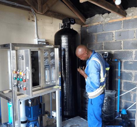 Man Fixing a Water Purifier